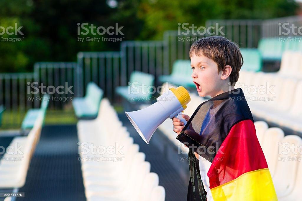 Germany fan screaming through megaphone on the stadium stock photo