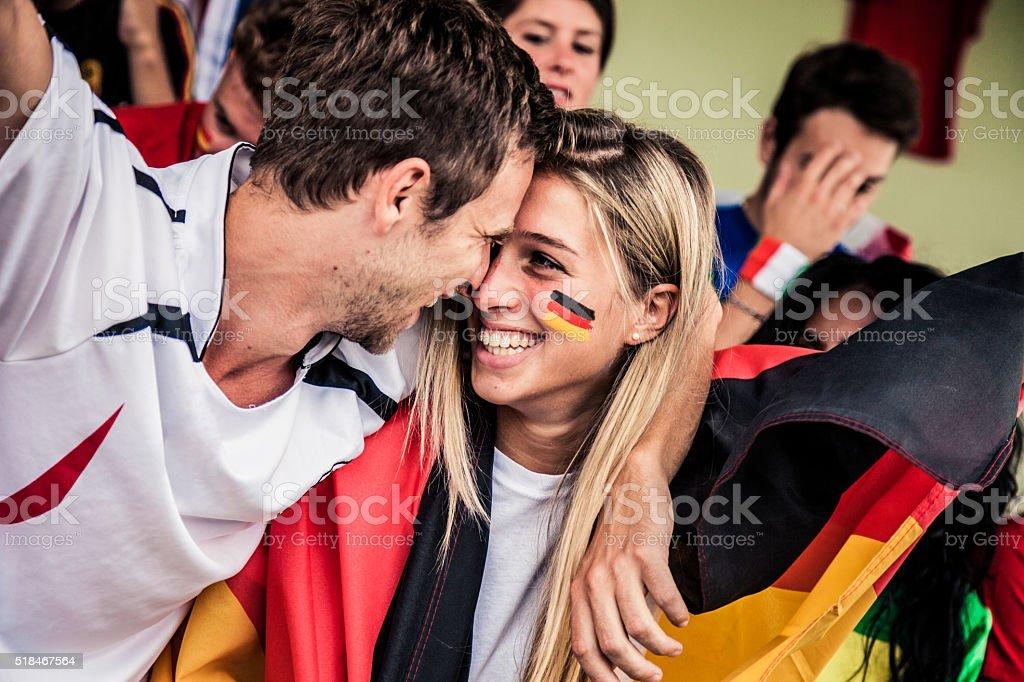 Germany fans kiss stock photo