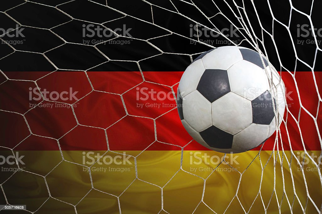 Germany flag and soccer ball, football in goal net stock photo