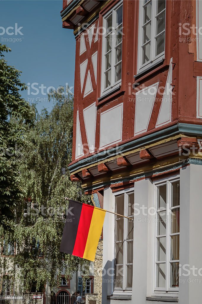 Germany flag on the facade of the old German house stock photo