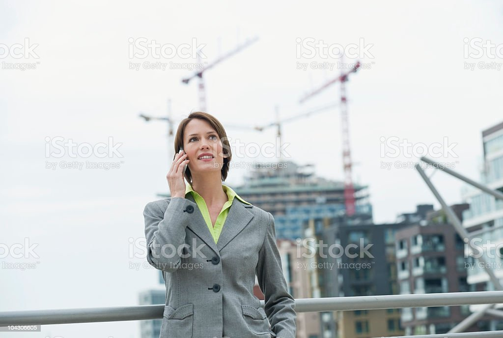 Germany, Hamburg, Business woman on the phone, smiling royalty-free stock photo