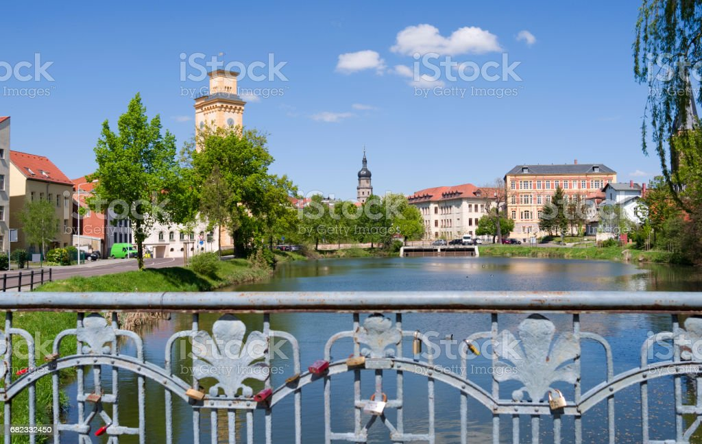 "Germany: View over the bridge railing with love locks at the ""Little Pond"" in Altenburg stock photo"