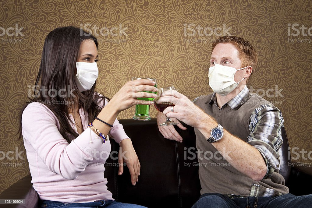 Germaphobe couple on a date stock photo