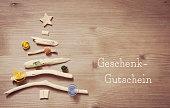 Geschenk-Gutschein - voucher in german
