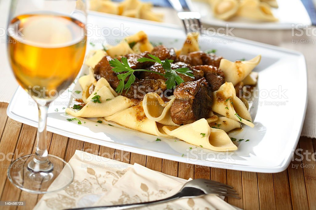 Gesse with pasta stock photo