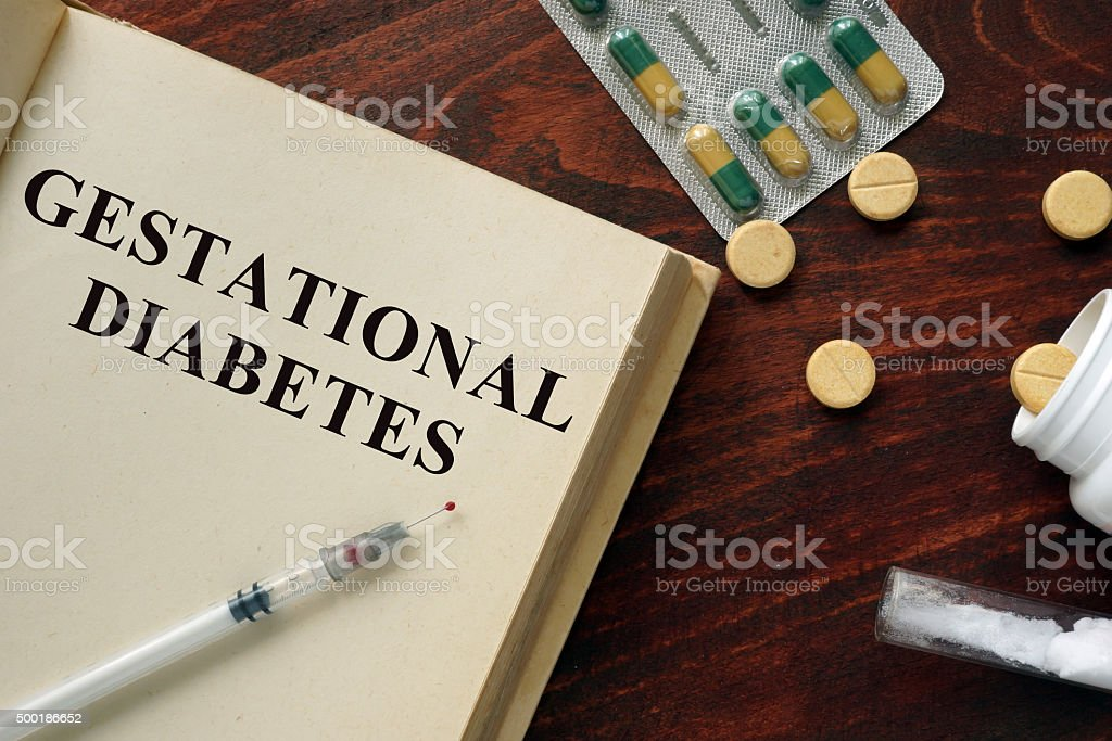 Gestational diabetes written on a book. Medical concept. stock photo