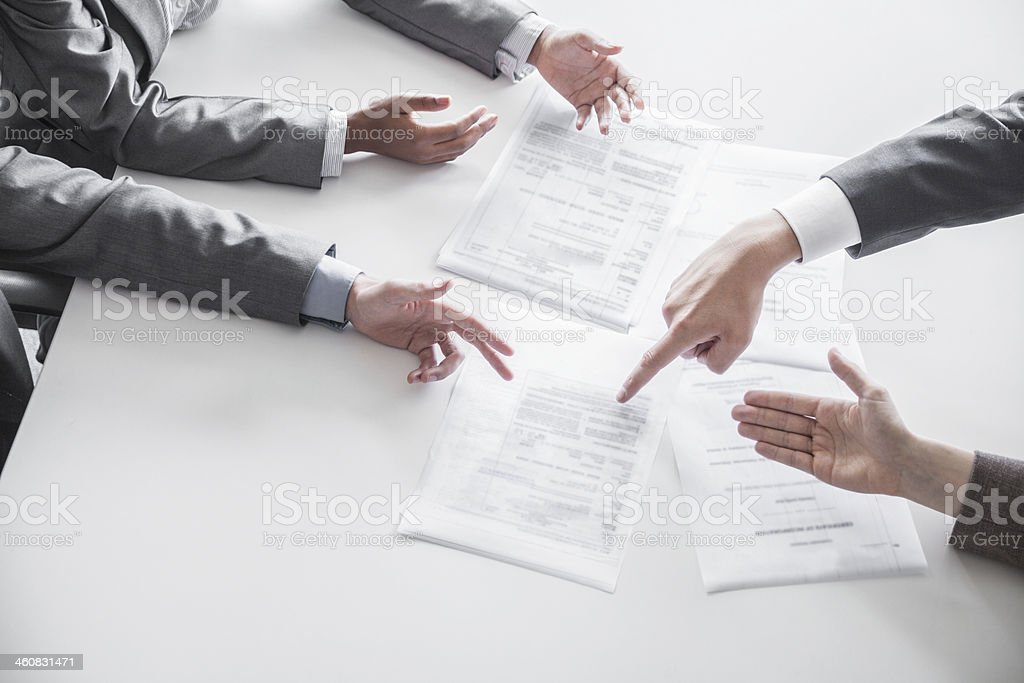 Gesturing hands at business meeting stock photo