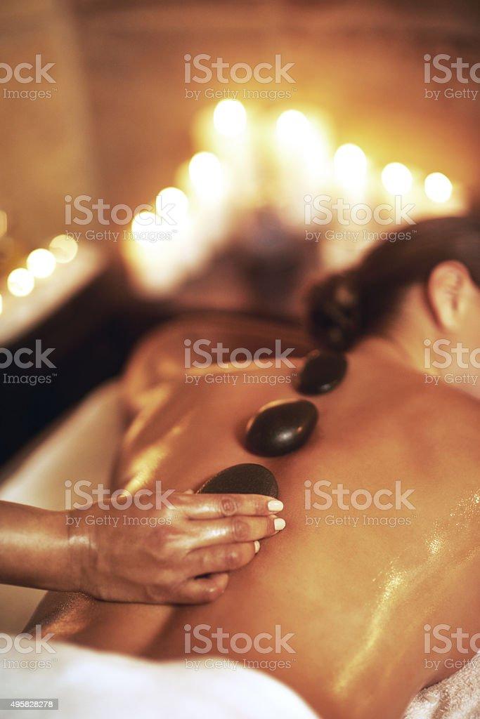 Get a hot stone massage stock photo