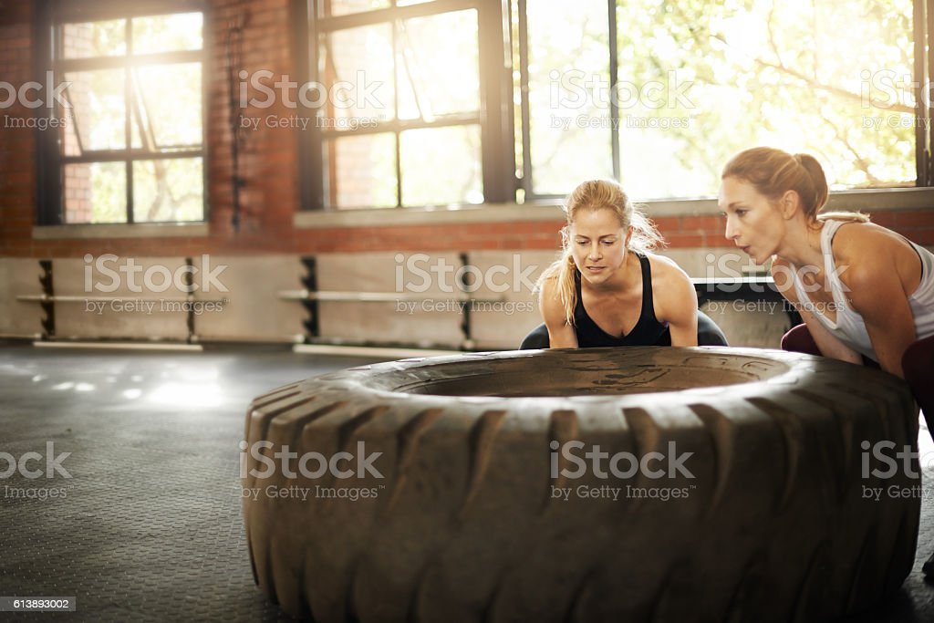 Get a total body workout with a tyre flip stock photo