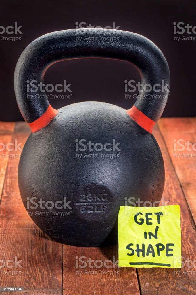 get in shape with heavy iron kettlebell stock photo