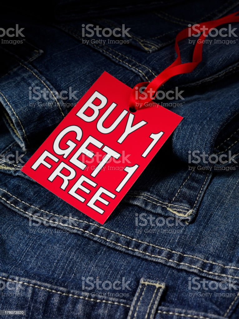 Get one free on Jeans royalty-free stock photo