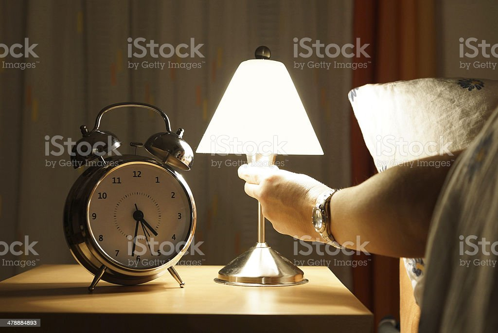 get out of bed in the middle of the night stock photo