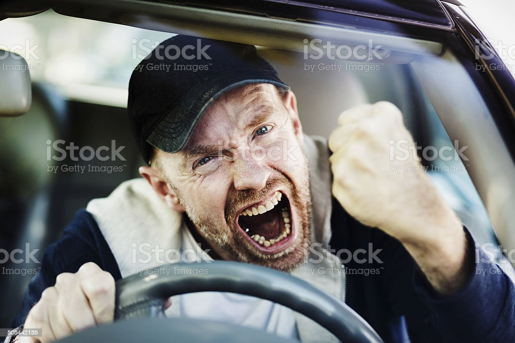 Get out of my way! Furious driver yells, shaking fist stock photo