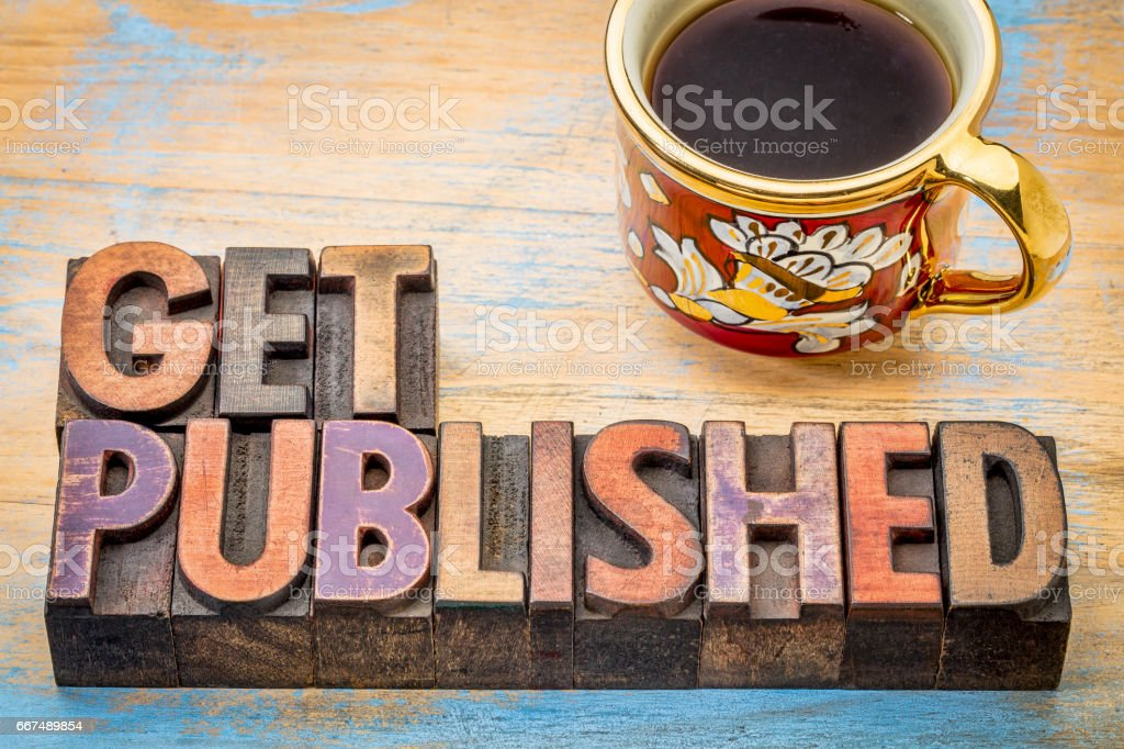 get published word abstract in wood type stock photo