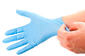 get ready for treatment doctors hand in blue hygienic glove