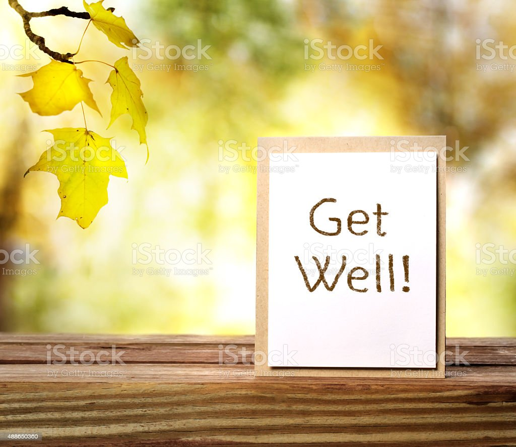 Get well message card over autumn background stock photo