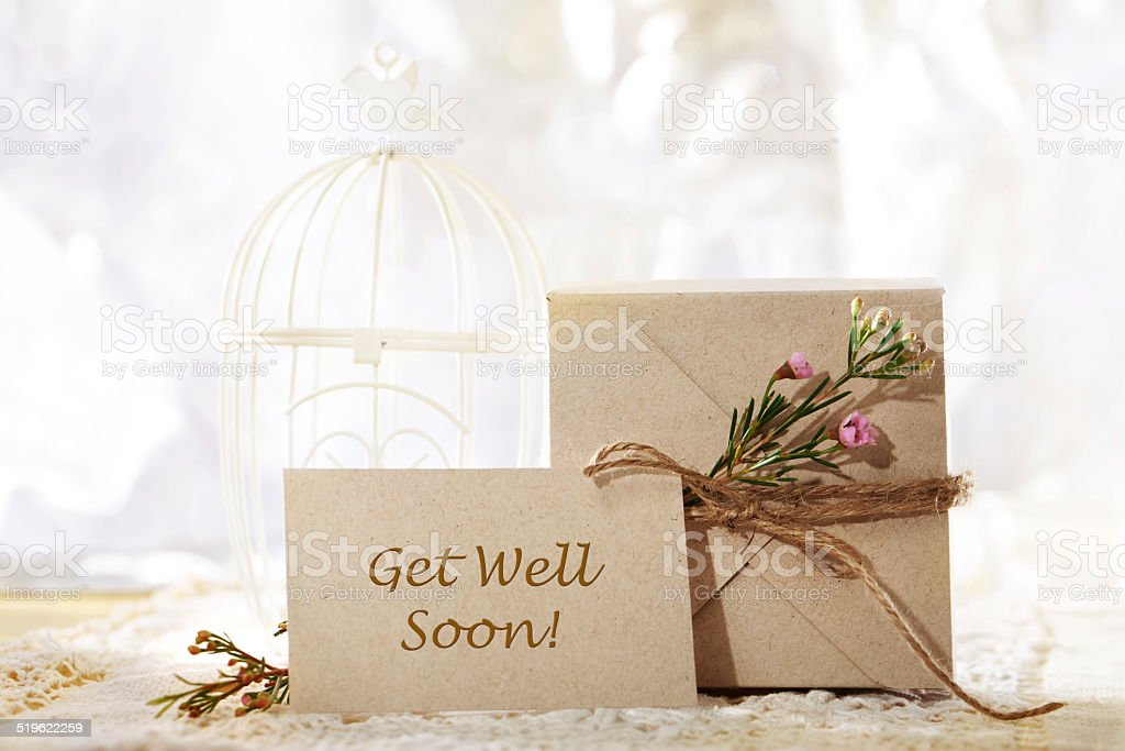 Get Well Soon hand crafted card and present box stock photo
