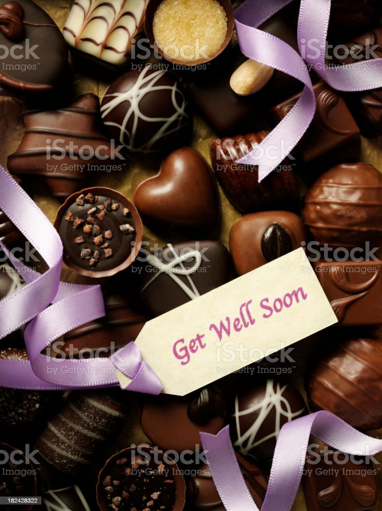 Get Well Soon Label and Chocolates royalty-free stock photo
