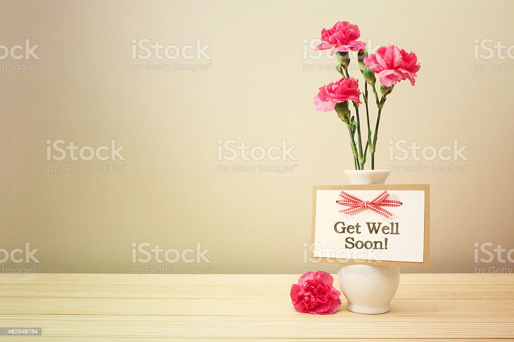 Get well soon message with pink carnations stock photo