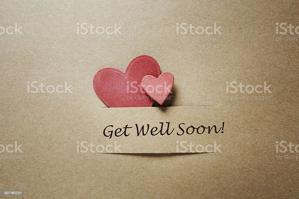 Get Well Soon message with red hearts stock photo