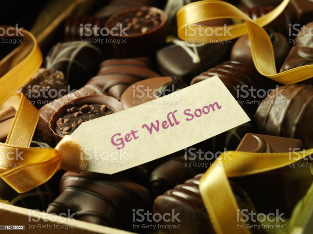 Get Well Soon with Ribbon and Chocolates royalty-free stock photo