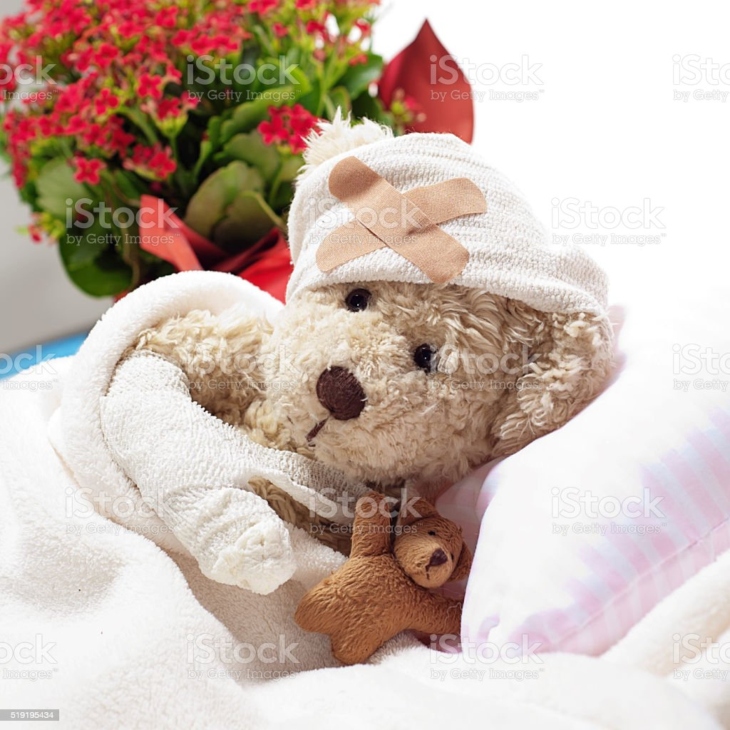 Get Well - Suffering Injured Sweet Teddy Bear stock photo