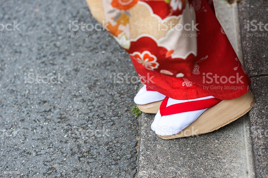Geta Sandals on the feet of Maiko Apprentice Japanese Geisha stock photo