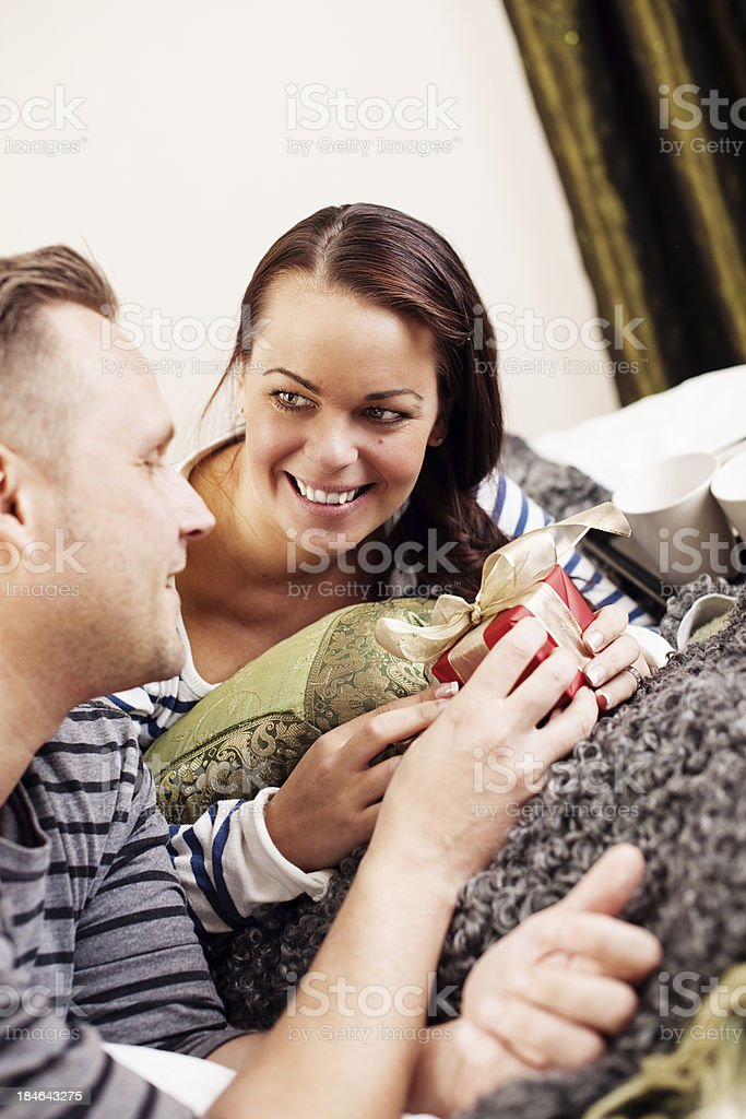 Getting a gift on christmas morning stock photo