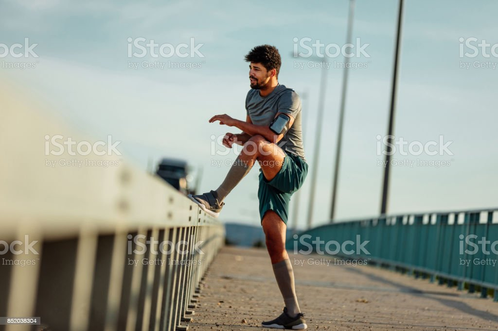 Getting a good stretch in before the run stock photo