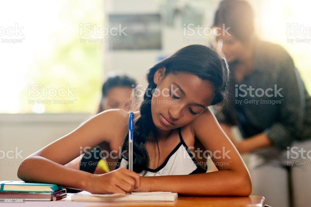 Getting a head start on her homework stock photo