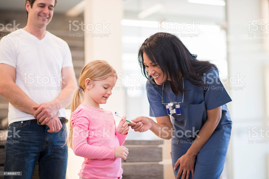 Getting a New Toothbrush at a Dental Appointment stock photo