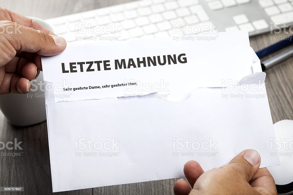 Getting a past due reminder notice. In German: Letzte Mahnung stock photo