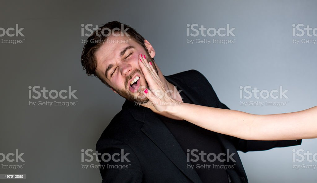 Getting a slap stock photo