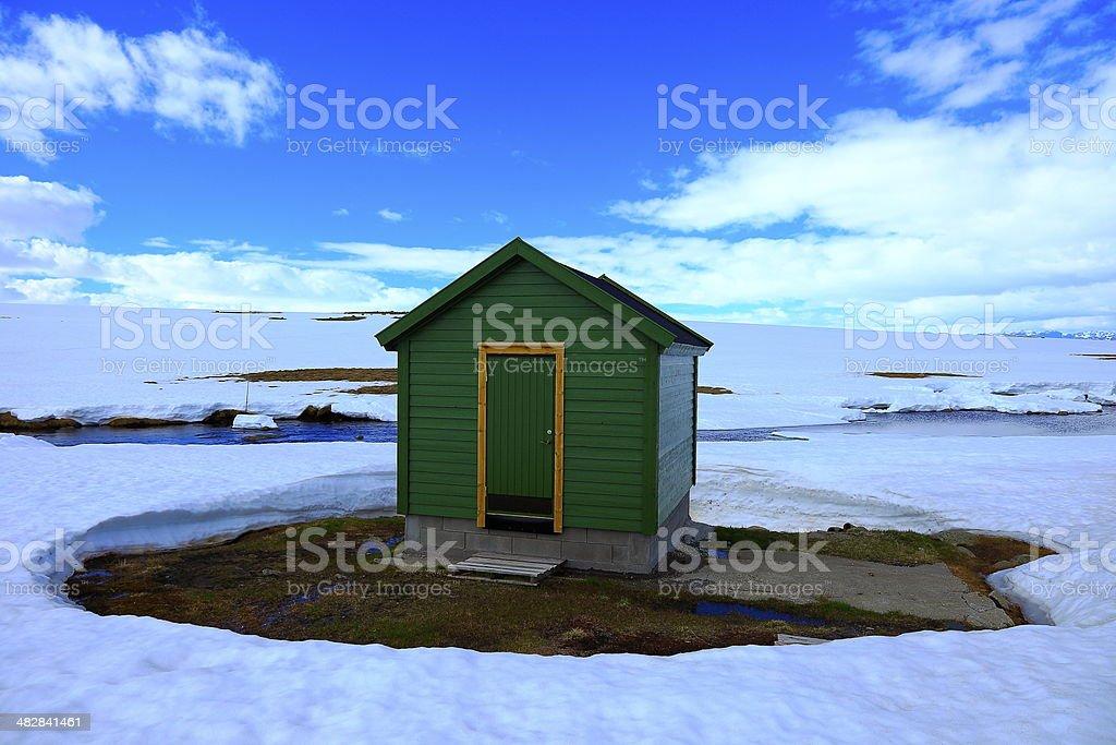 Getting away - Log Cabin far away in snow - Norway, Scandinavia stock photo