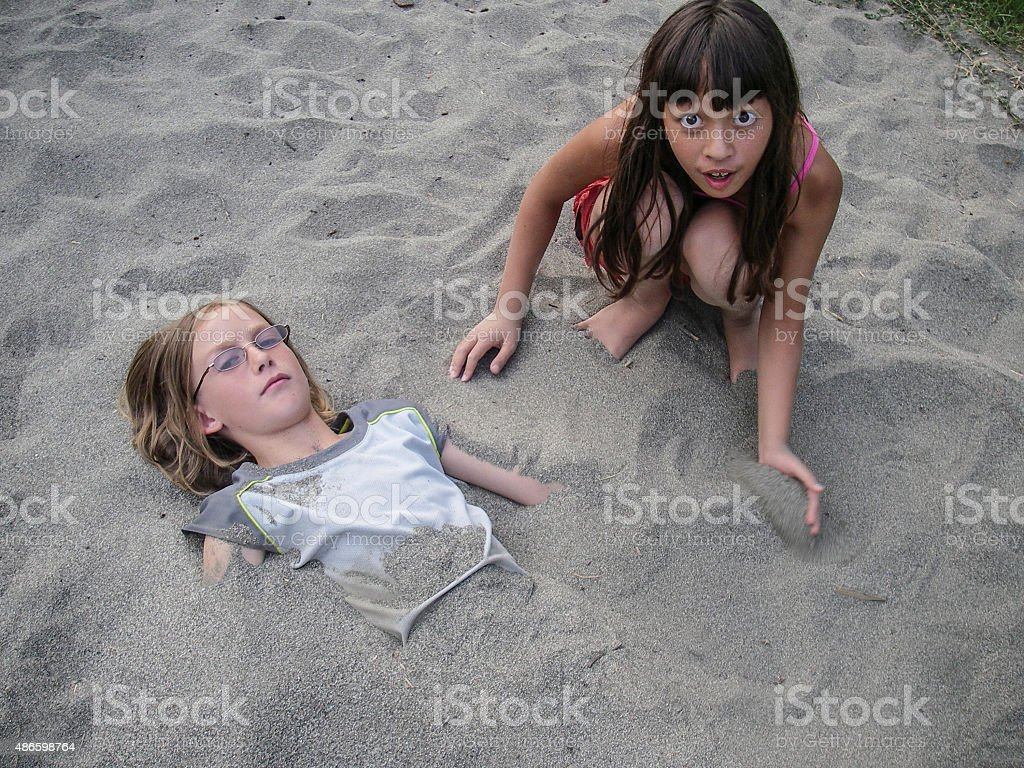 Getting Burried stock photo