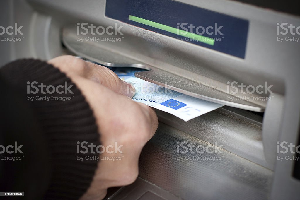 Getting cash at ATM machine royalty-free stock photo