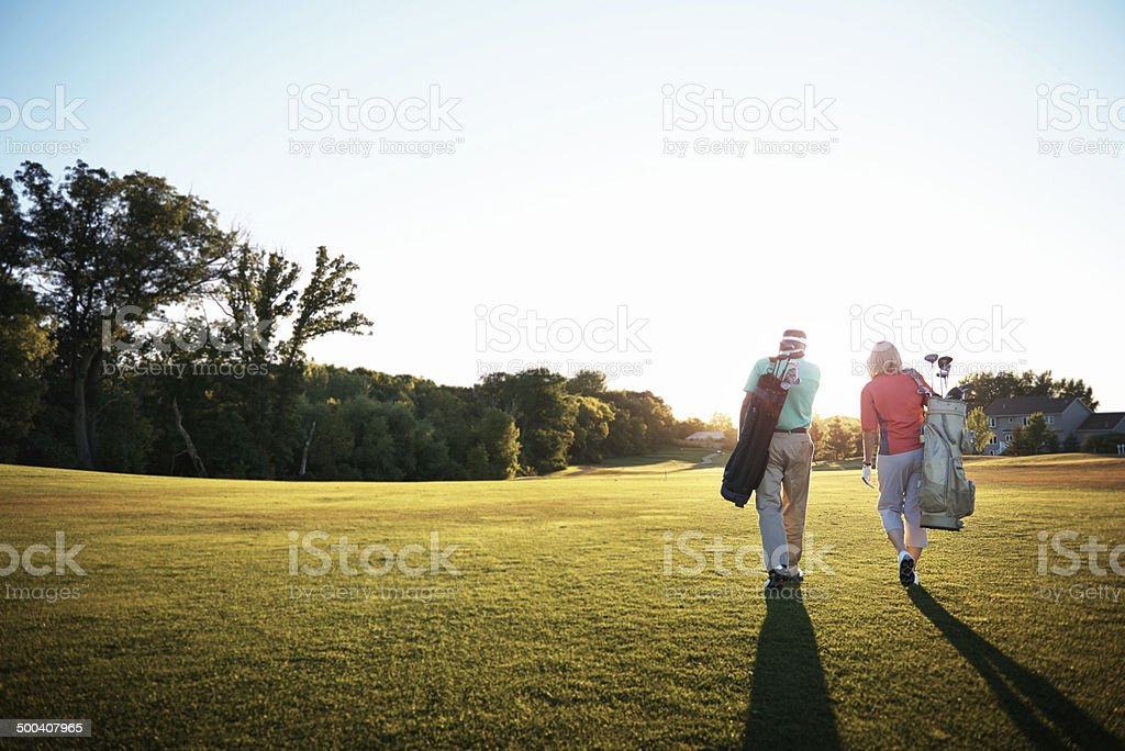 Getting down to some golf stock photo