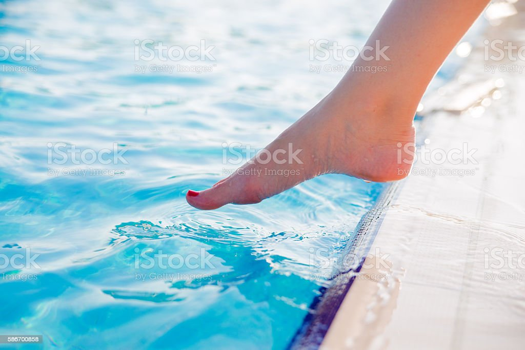 Getting  feel for the water, Toes dipping in water stock photo