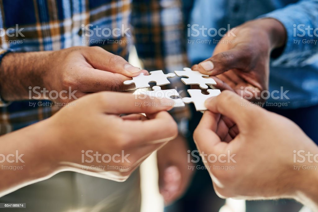 Getting hands on in the problem solving process stock photo