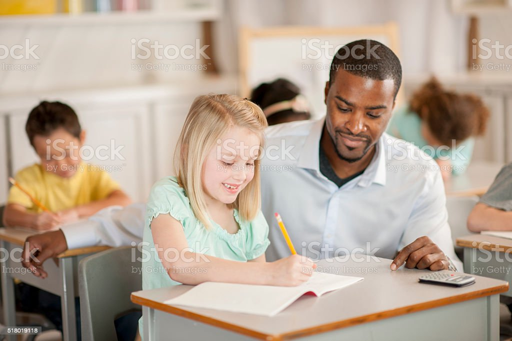 Getting Help from a Teacher stock photo
