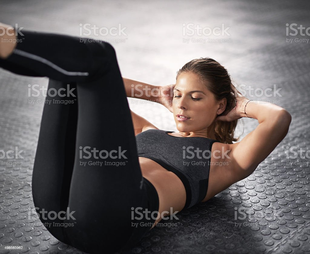 Getting her abs in shape stock photo