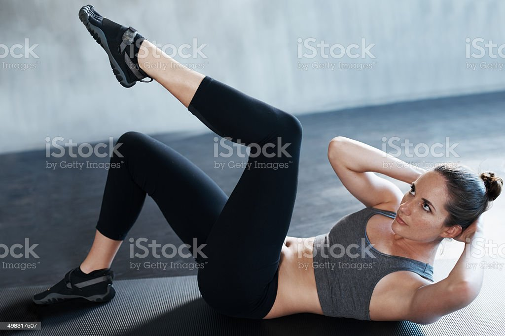 Getting her abs nice and trim stock photo