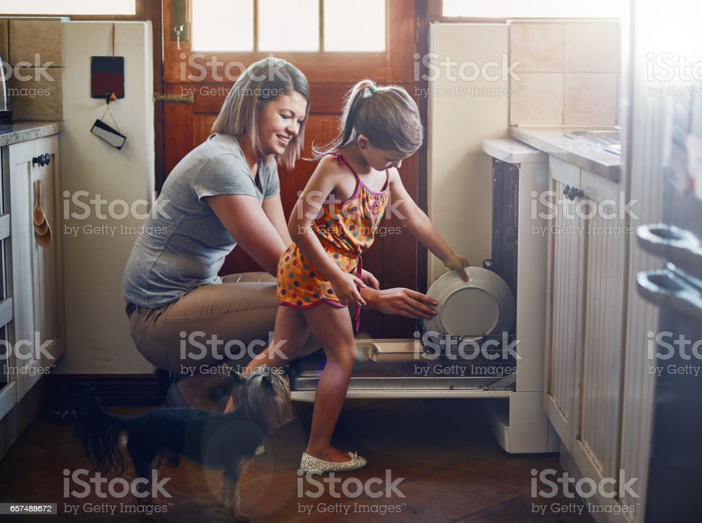 Getting her to help with the chores from a young age stock photo