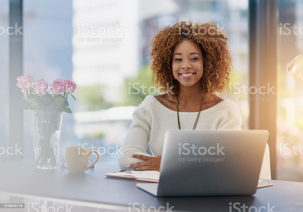 Getting her work done with a smile stock photo