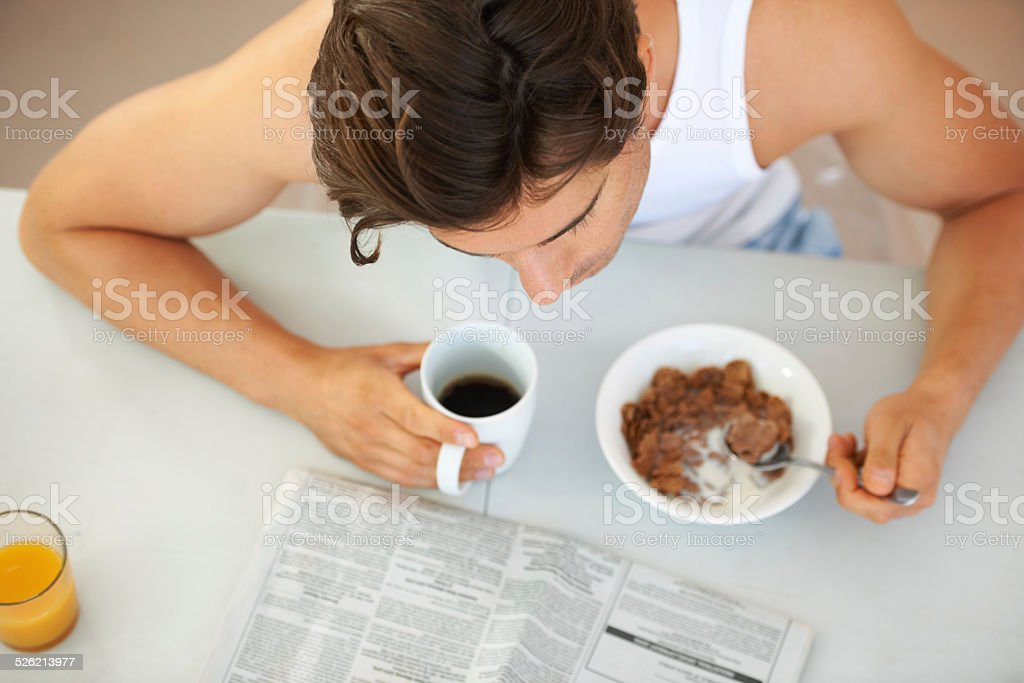 Getting his morning news fix stock photo