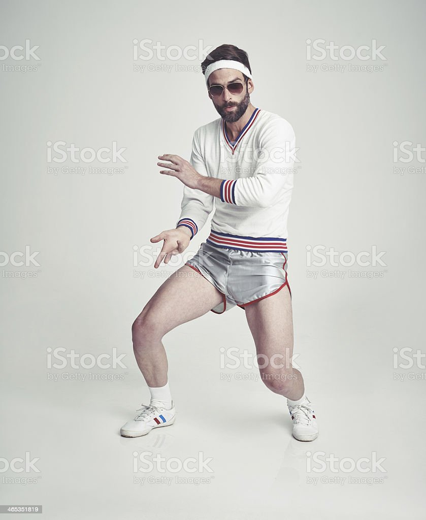 Getting his retro fitness on stock photo