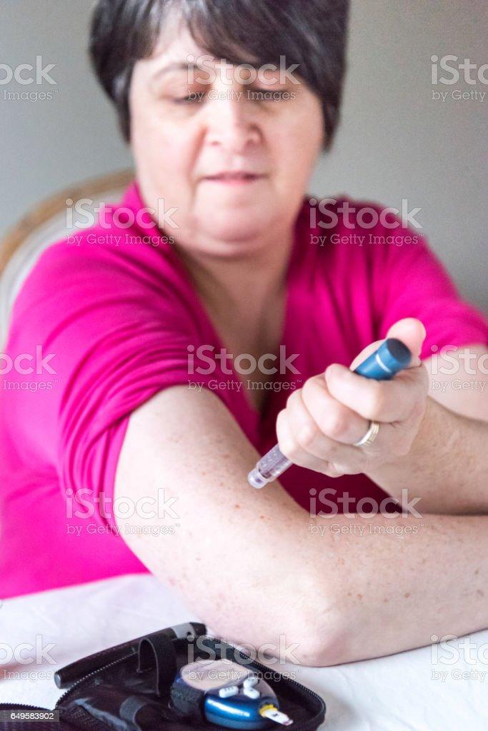 getting insulin shot stock photo