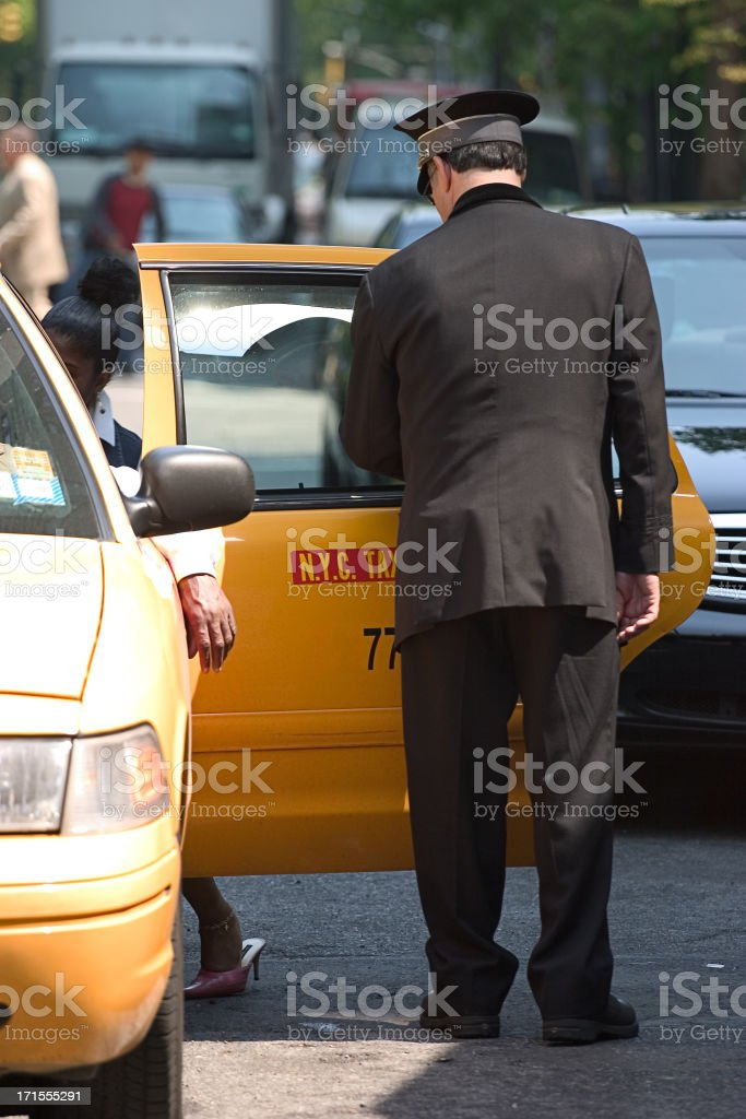 Getting into taxicab royalty-free stock photo