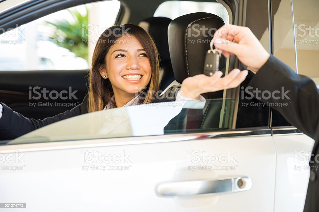 Getting keys for my brand new car stock photo