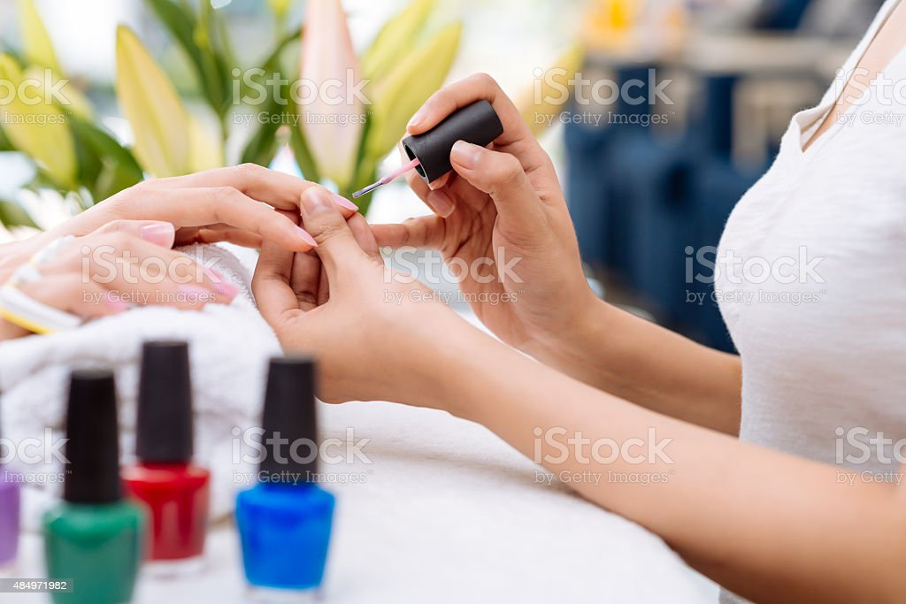 Getting manicure stock photo